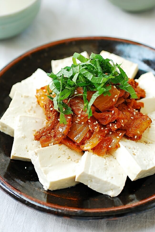 Stir-fried kimchi and pork served with boiled tofu