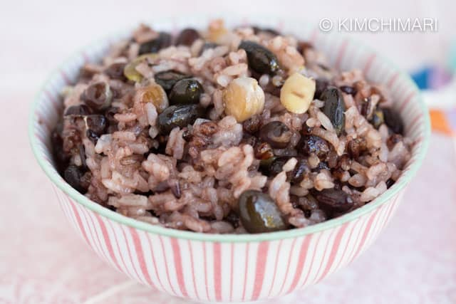 Closeup of multigrain rice cooked in pink striped bowl