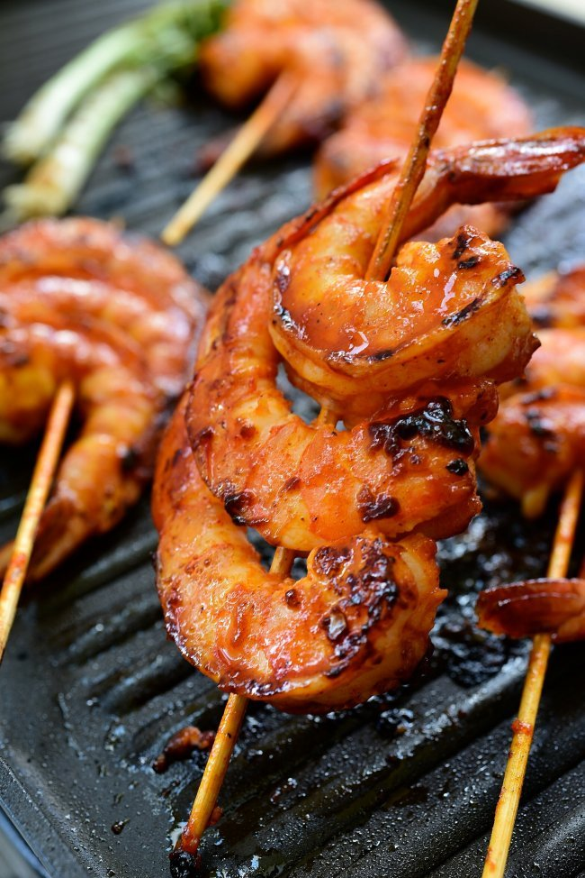 Spicy red shrimp skewers in a grill pan