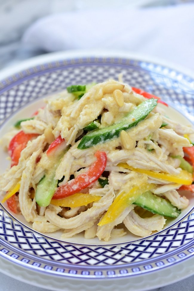 Korean Chicken Salad Mixed with Pine Nut Dressing, cucumber and bell pepper slices