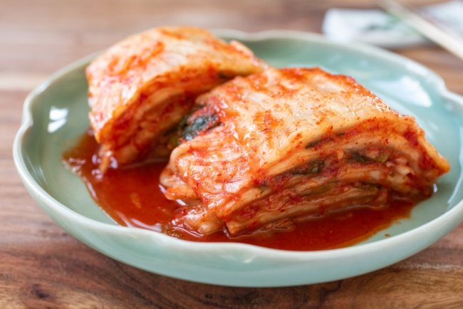 cut traditional kimchi in a green plate