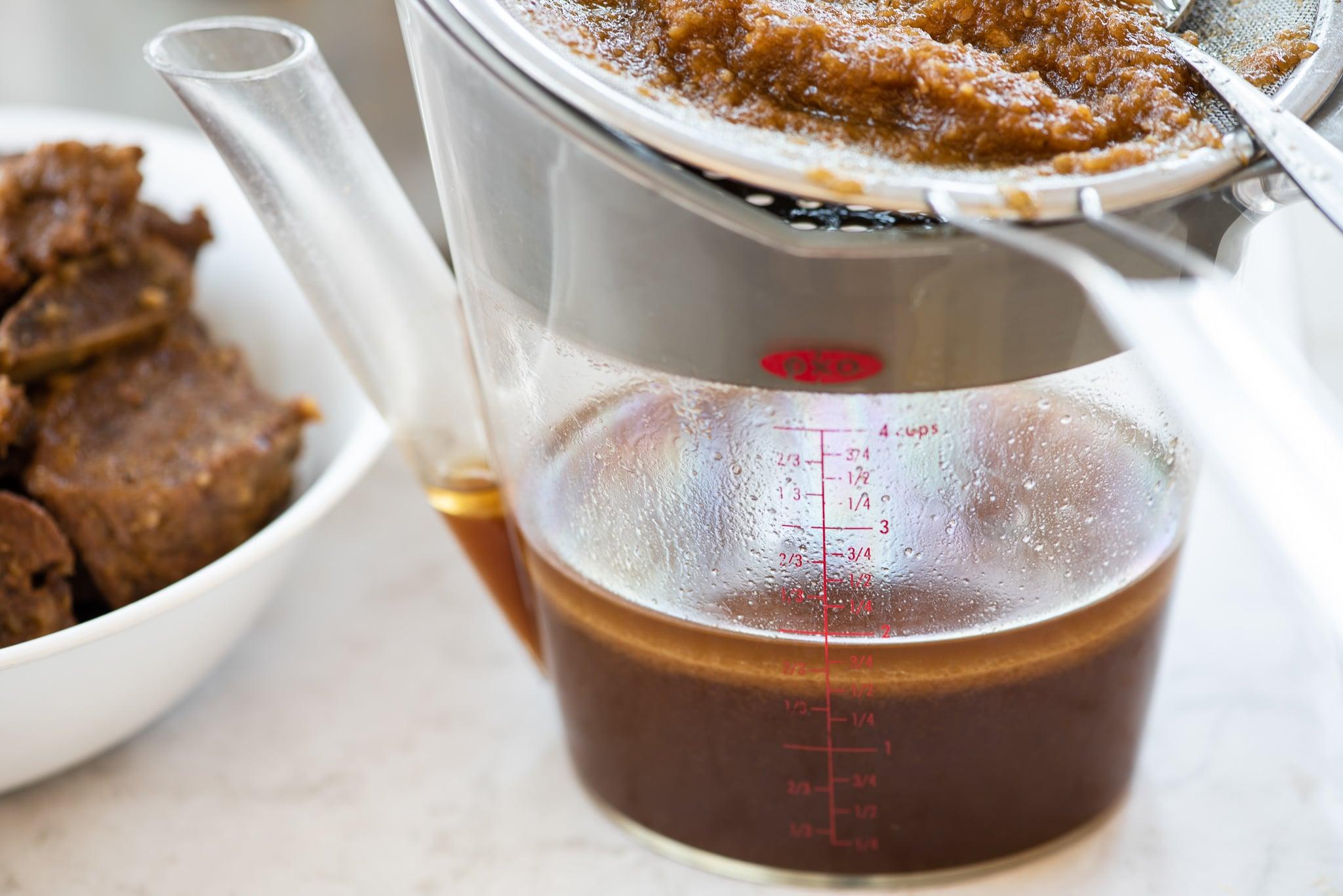 Straining the braising liquid